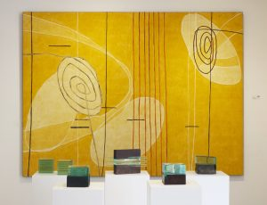 Painting by Mario Velez and sculptures by Ronny Vayda, yellow, miami etra fien art gallery, buy art, miami etra fine art, art week miami, famous comtemporary painter, famous modern sculptures for sale